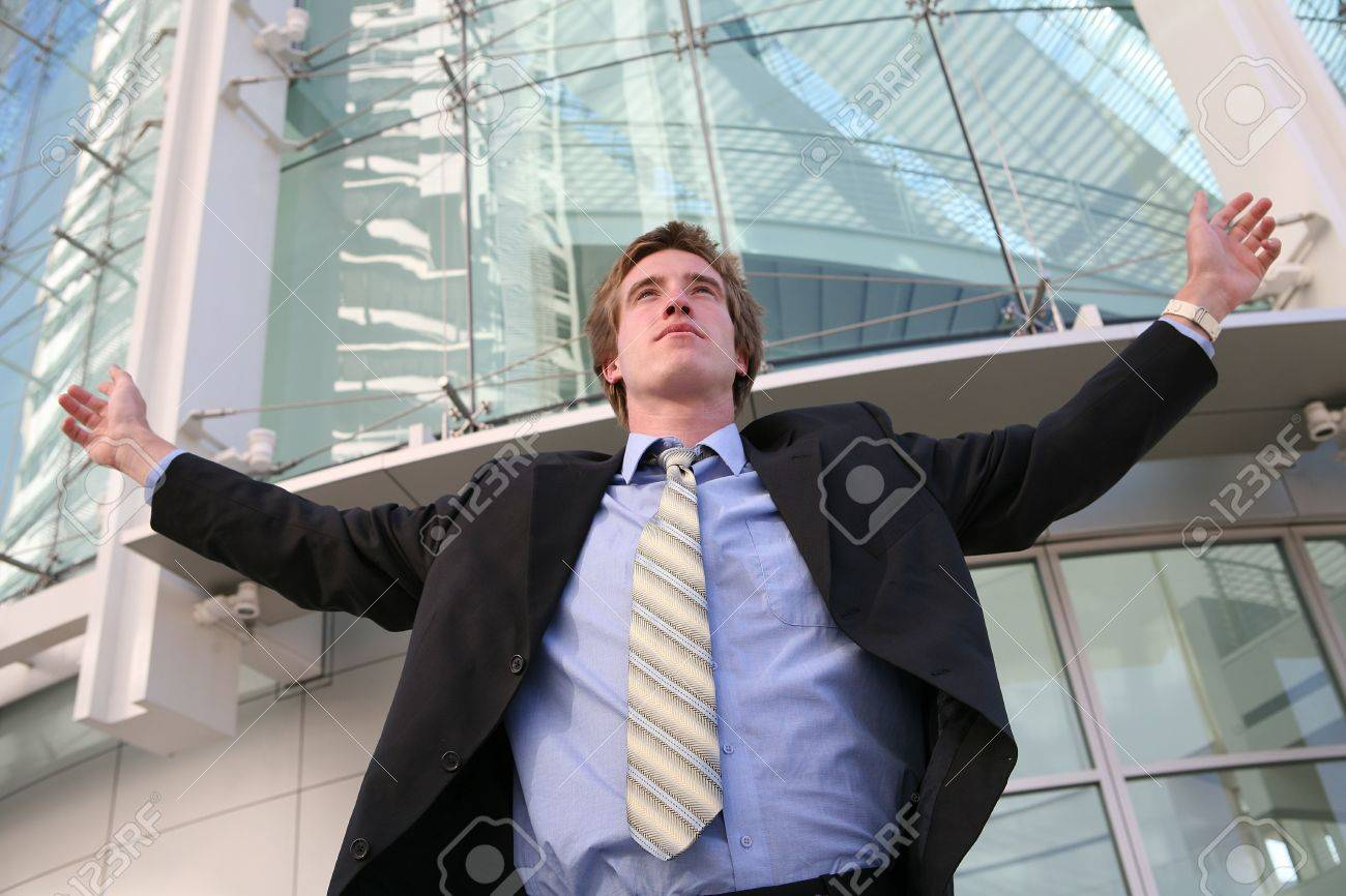 A business man celebrating success outside his office building Stock Photo - 603442