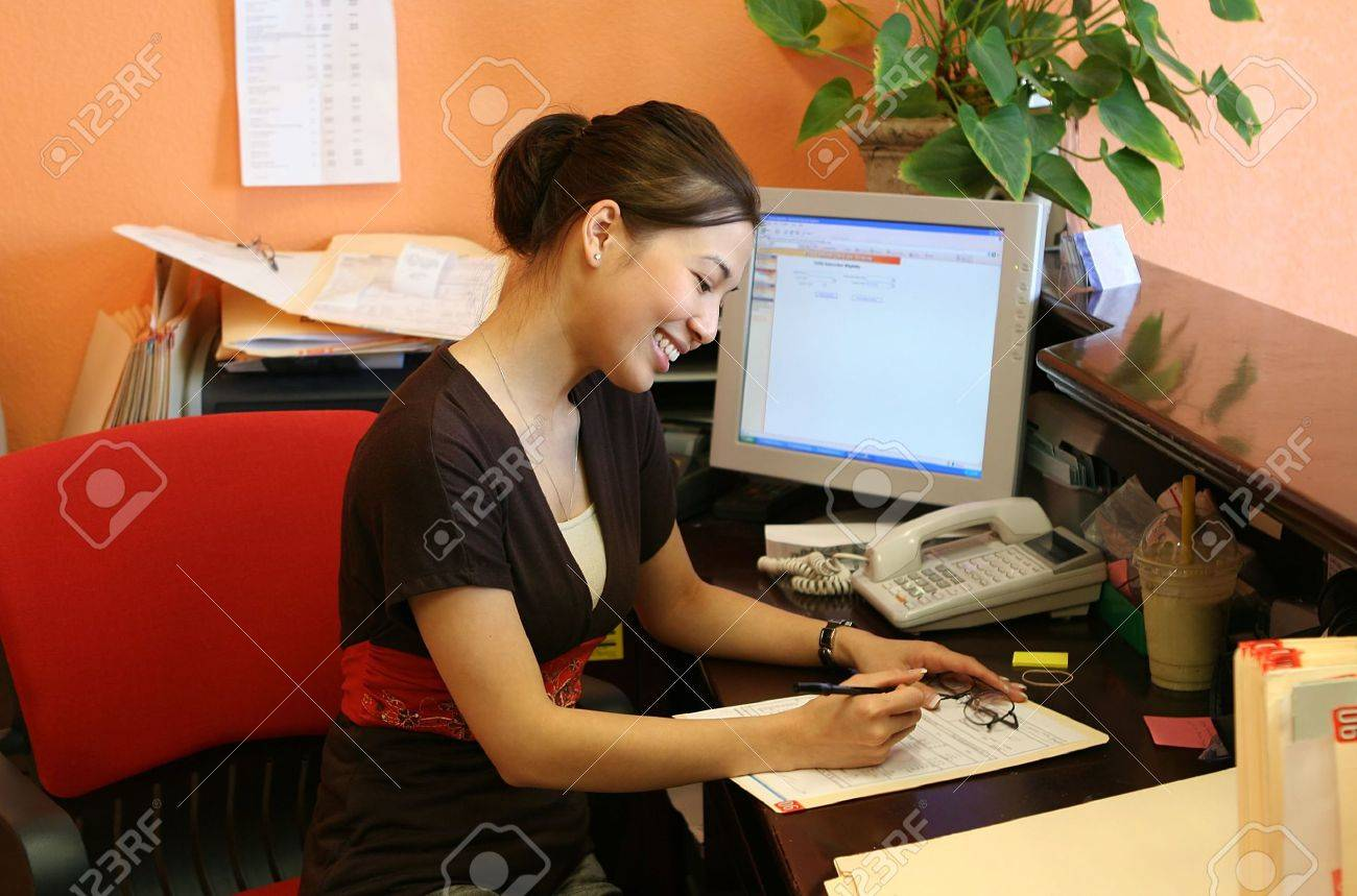 a w receptionist working hard at the front desk stock photo a w receptionist working hard at the front desk stock photo 637455