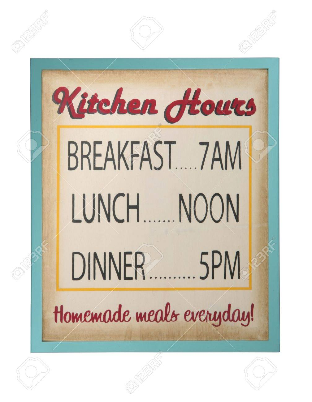 A sign for the kitchen displaying breakfast lunch and dinner hours stock photo 683902