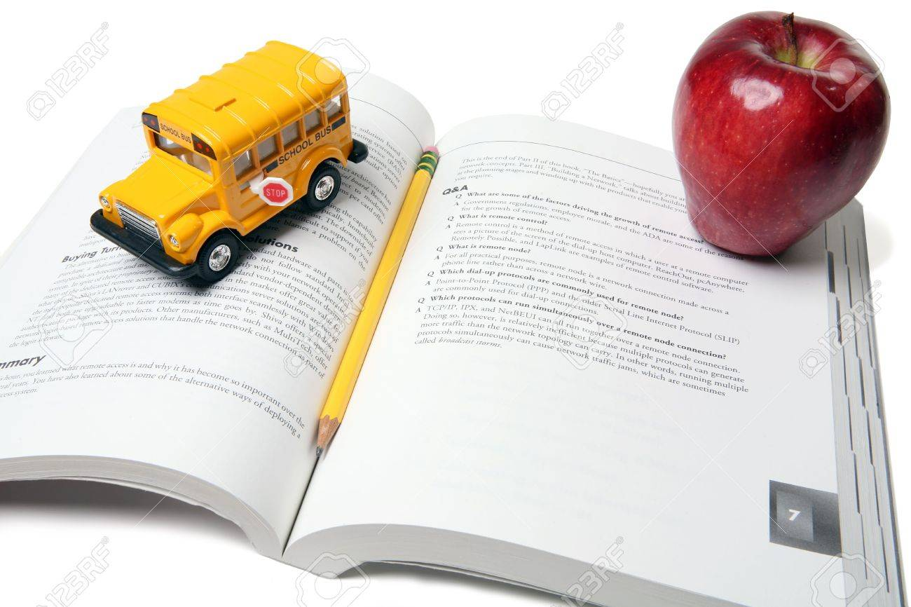 School bus, book, apple and pencil in education themed display