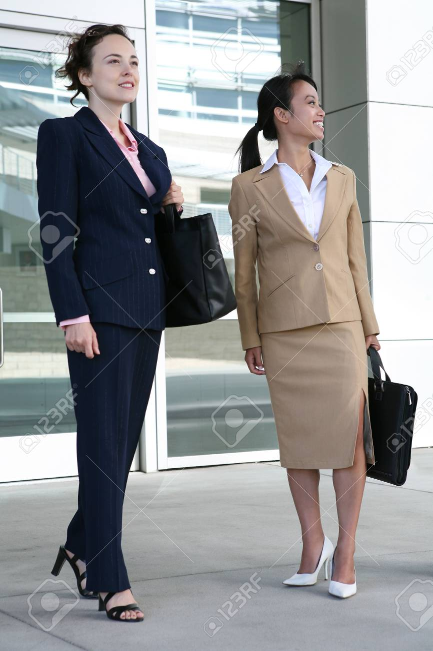 Two attractive business woman leaving their company Stock Photo - 1356256
