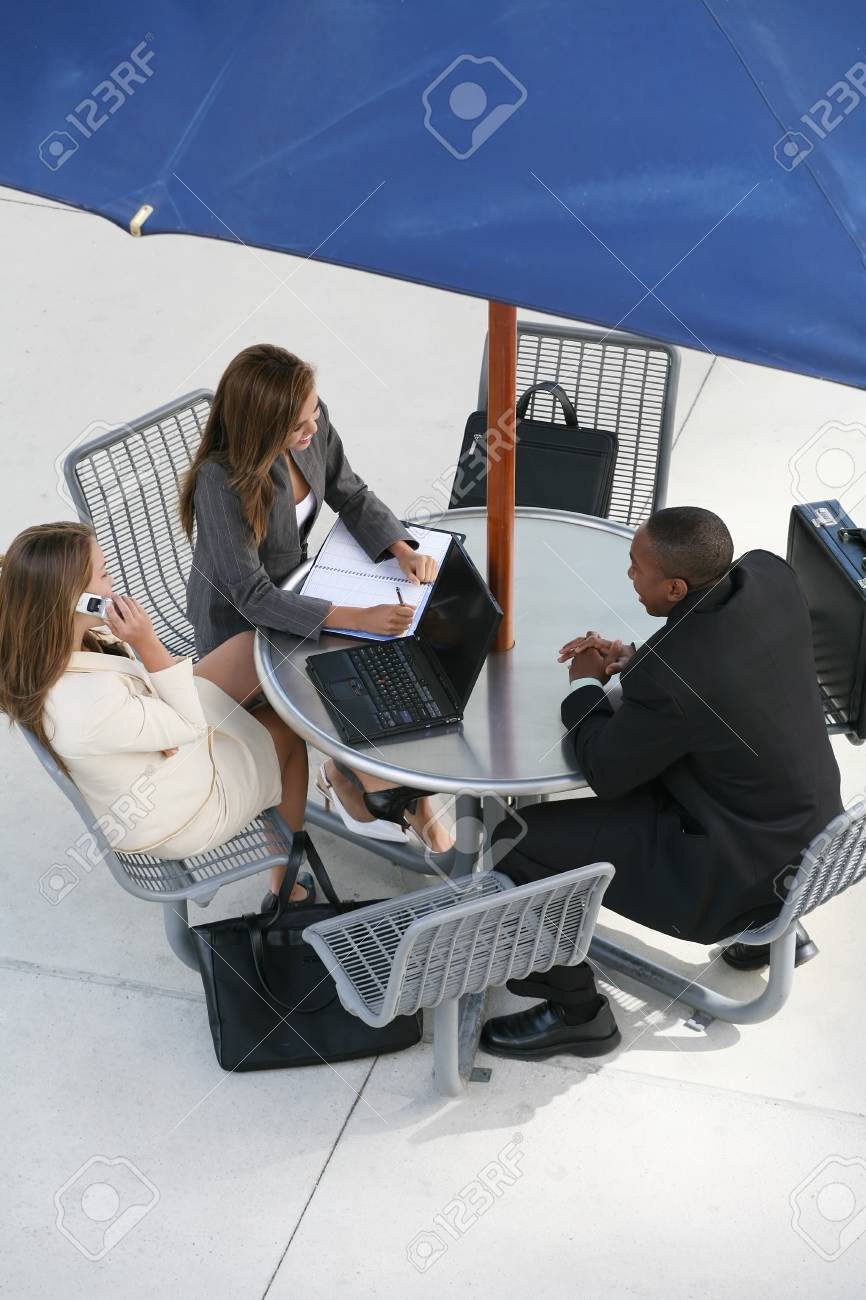 A business tean of two women and a man at a table Stock Photo - 1565935