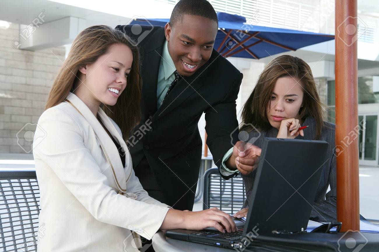 A business tean of two women and a man discussing a project Stock Photo - 1666901