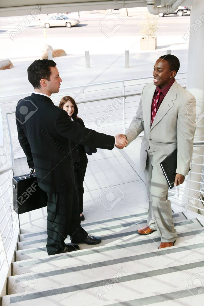 Two handsome business men shaking hands to confirm a deal Stock Photo - 2382018