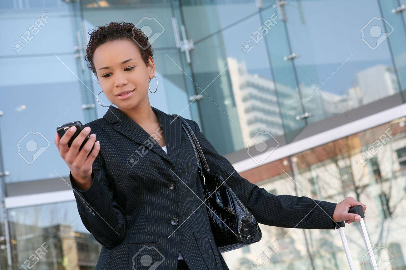An african american business woman answering cell phone Stock Photo - 2630710