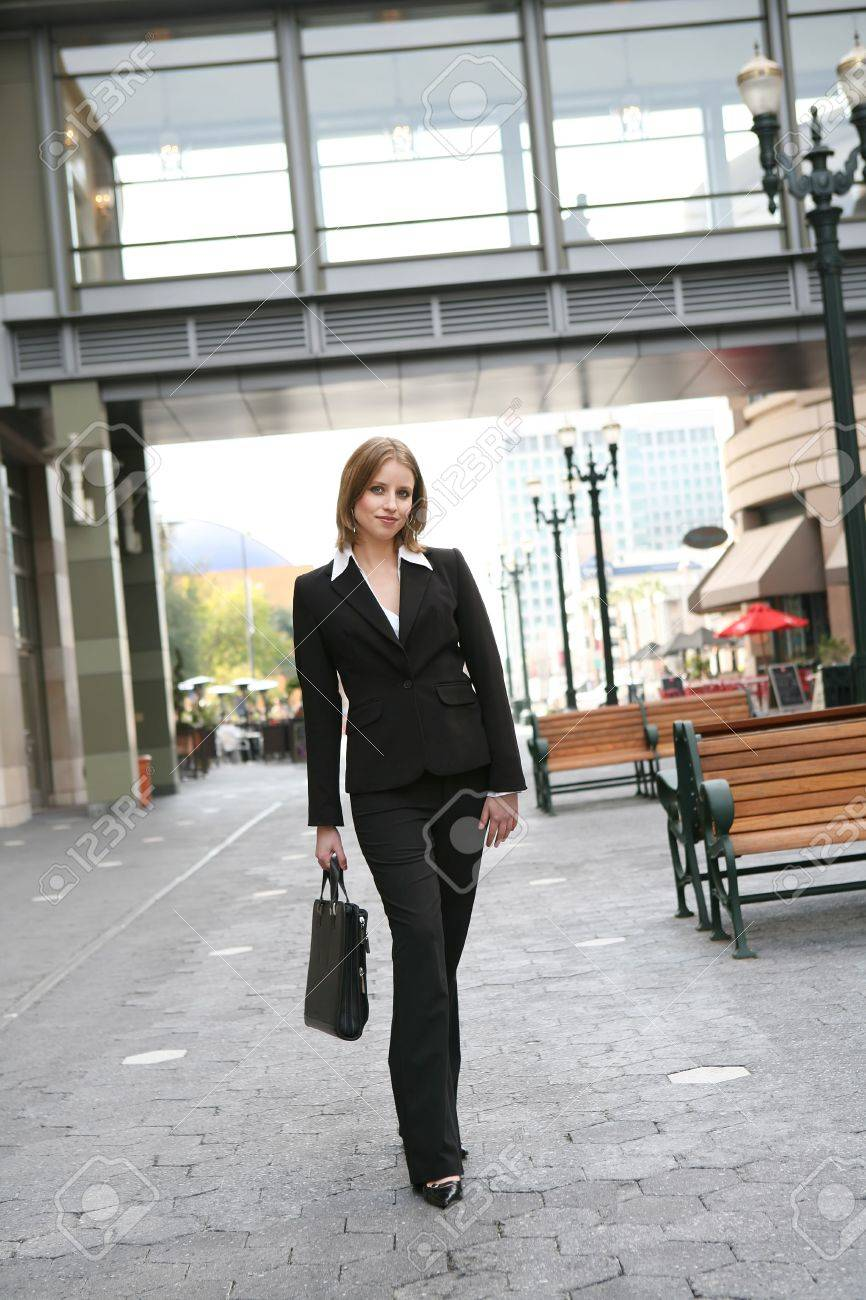 a pretty blonde business w walking to work stock photo a pretty blonde business w walking to work stock photo 2640750