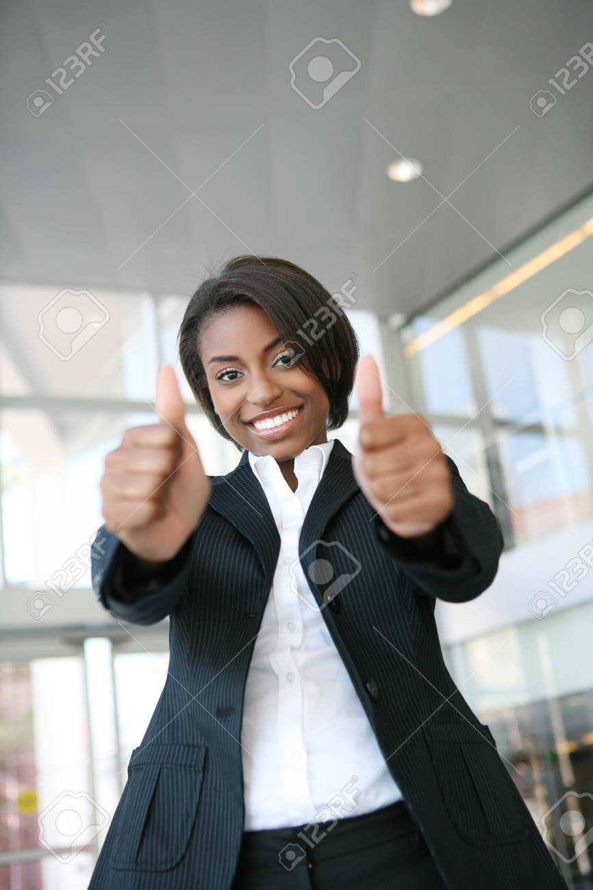 A pretty african american business woman with thumbs up Stock Photo - 2709530