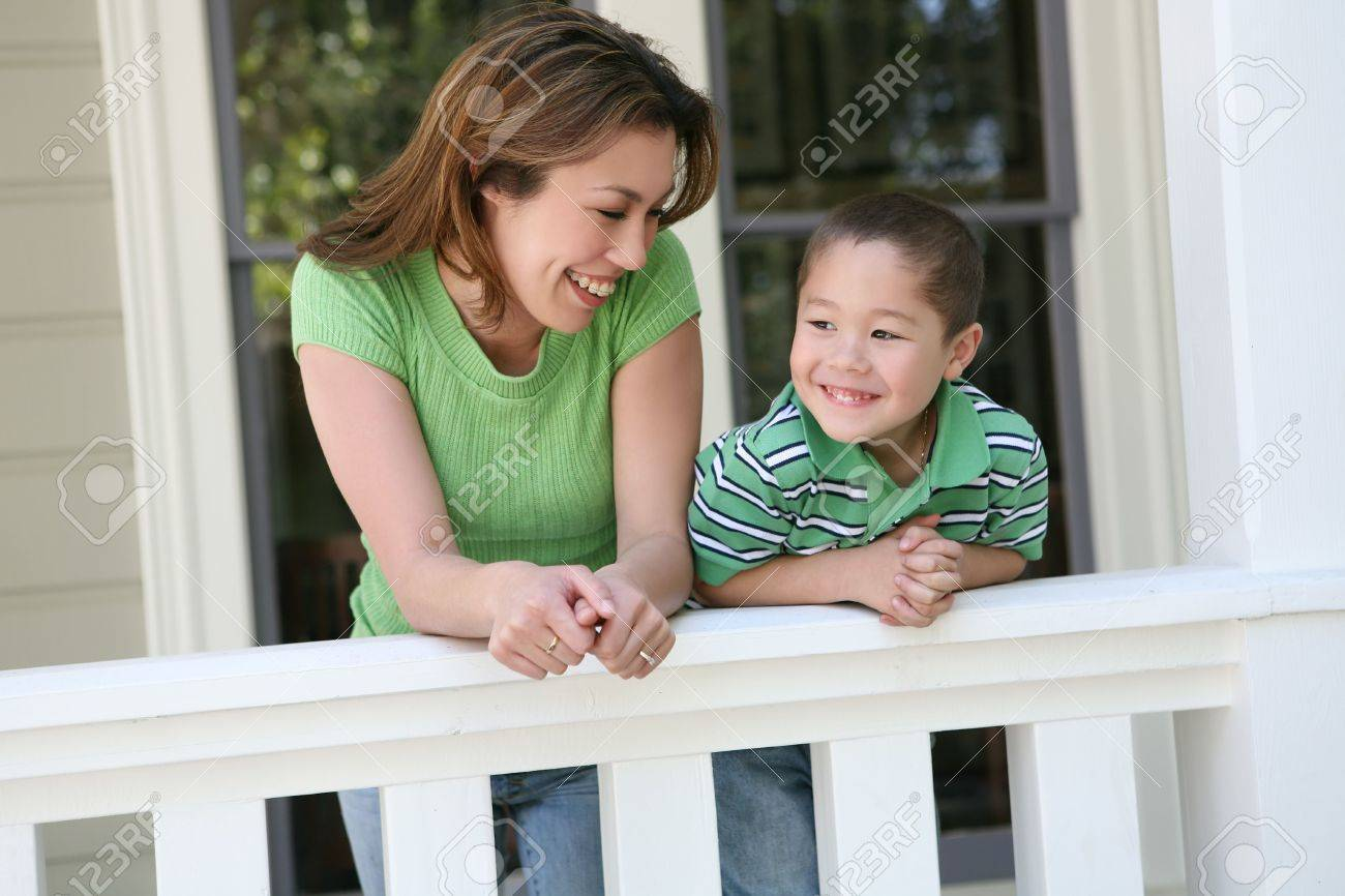An attractive mother and son family outside their house Stock Photo - 2886918