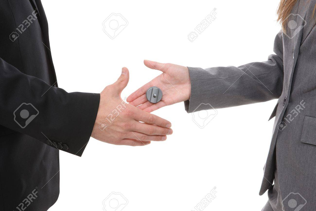 Business team shaking hands with a buzzer shock surprise Stock Photo - 4278076