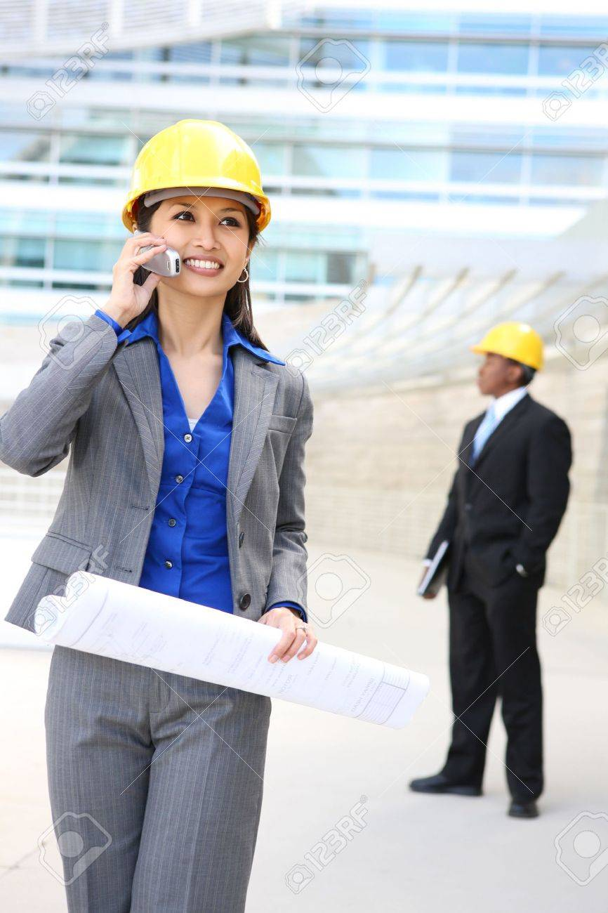 A pretty asian woman working as architect on a construction site Stock Photo - 4857176