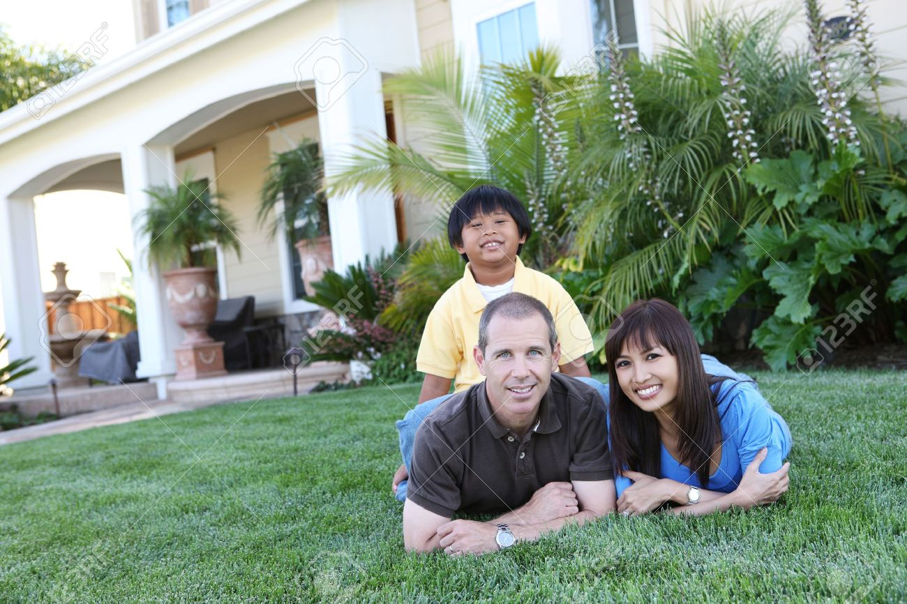 Attractive Happy Family Outside Their Home Having Fun Stock Photo ... for Happy Filipino Family At Home  56mzq