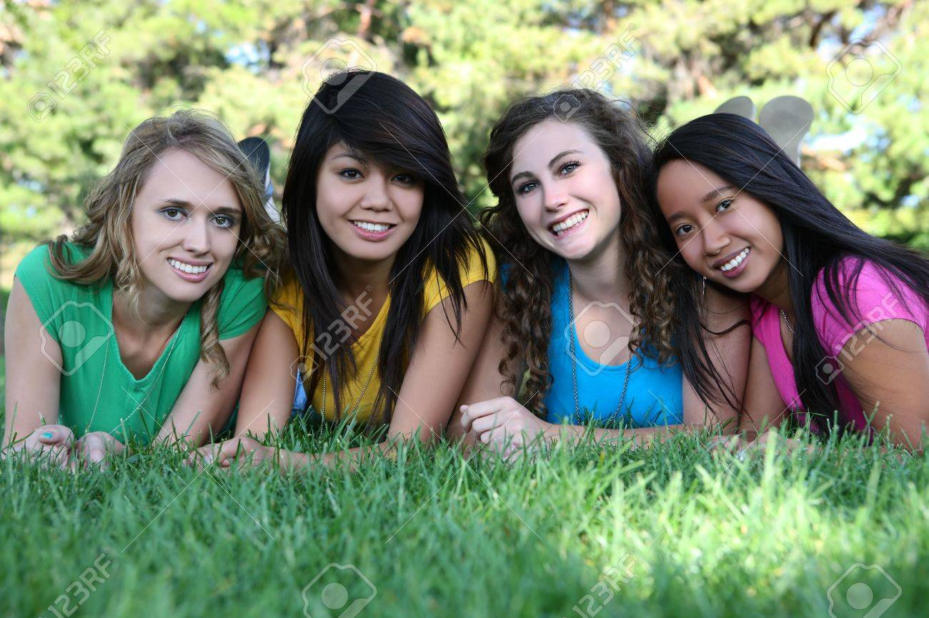 Smiling Happy girl friends in the park with colorful shirts Stock Photo - 5096757