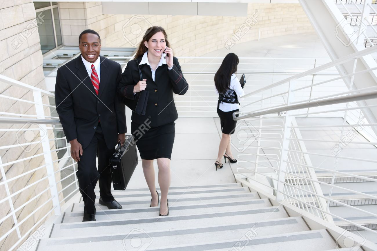 attractive diverse business man and w team walking up stairs attractive diverse business man and w team walking up stairs to work stock photo 5303947