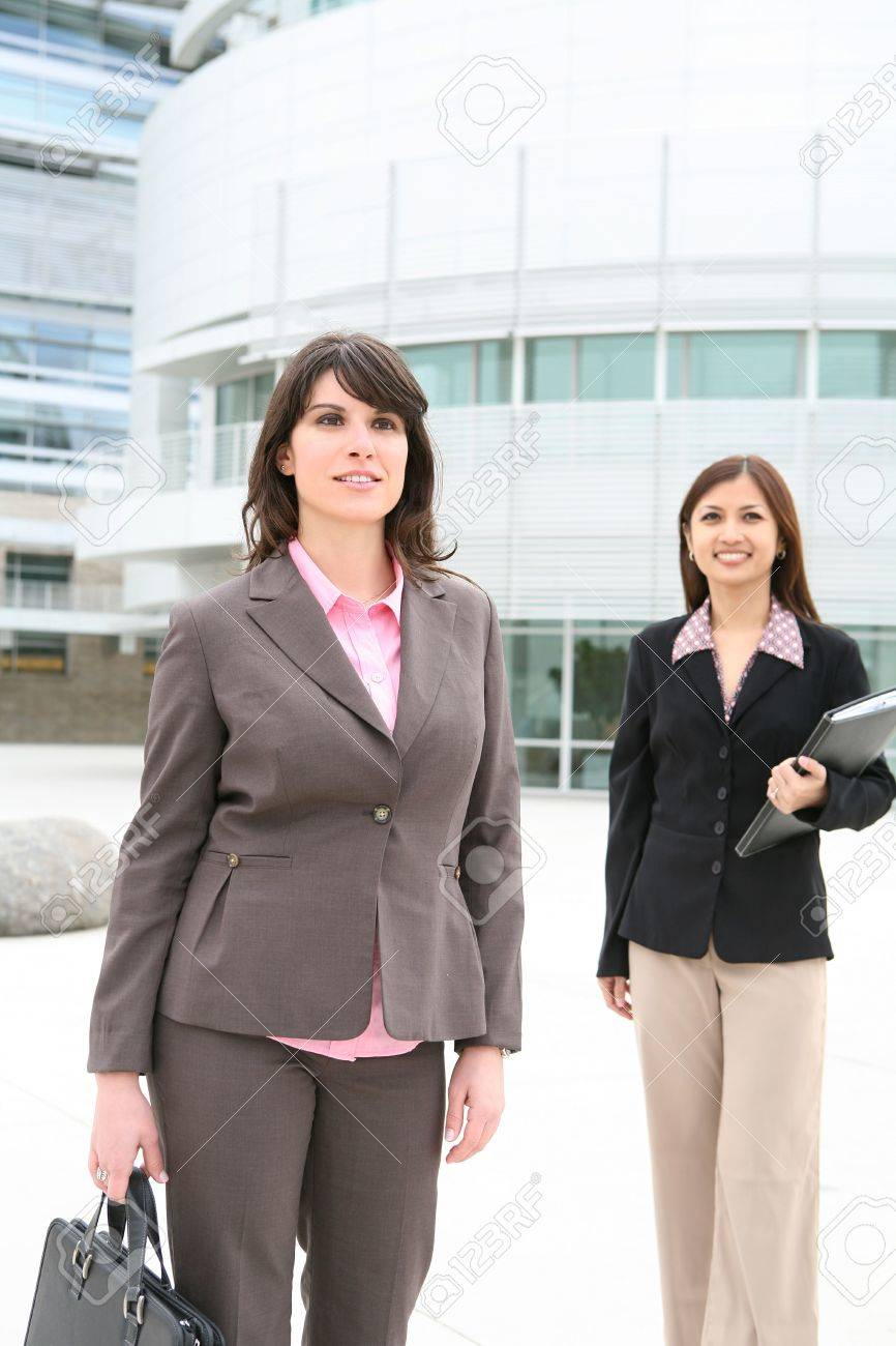 pretty business women walking to work at the office building stock pretty business women walking to work at the office building stock photo 6155976