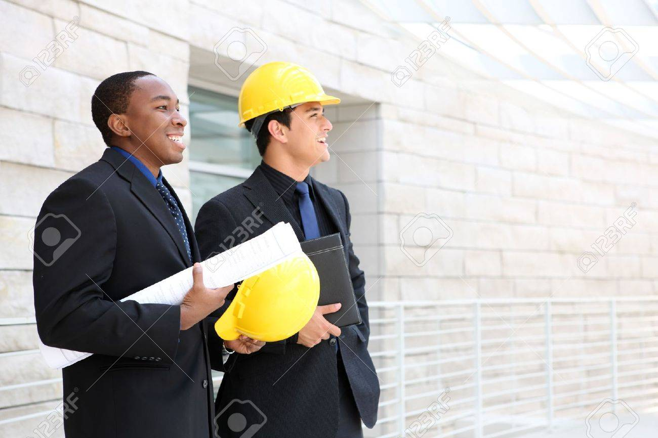 An attractive business team working construction on the building site Stock Photo - 6308456