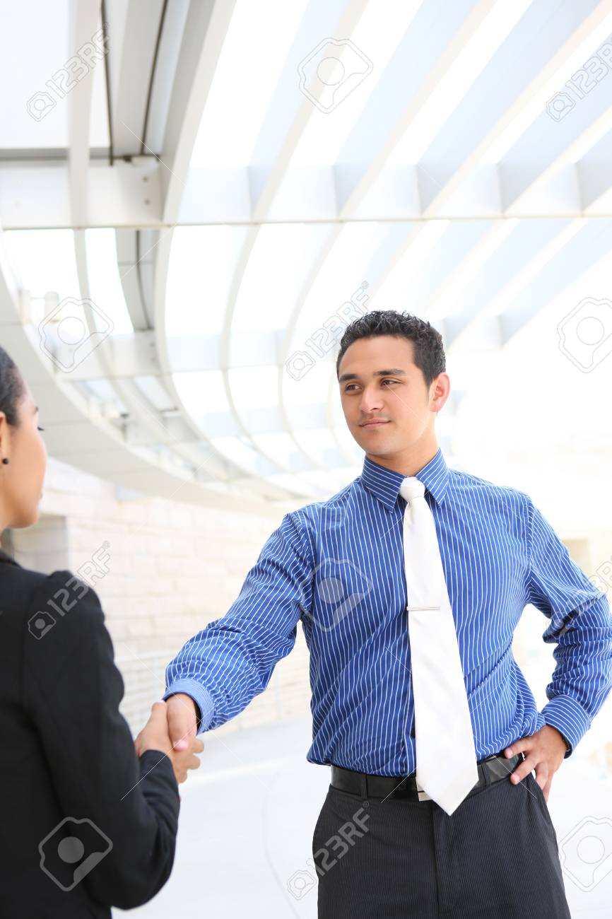 Attractive man and woman business team shaking hands at office building Stock Photo - 6384750