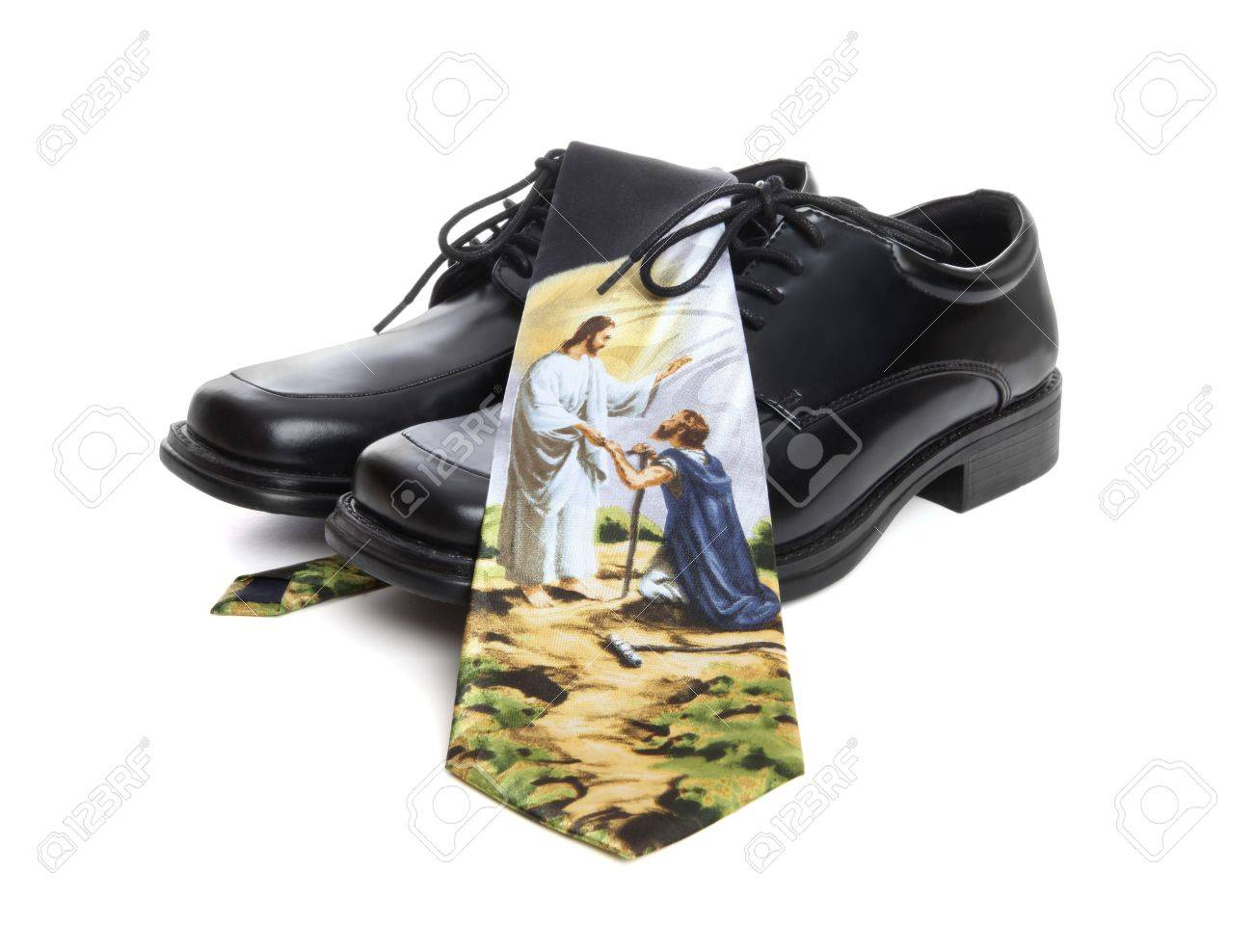A business man's shoes and religion themed tie over white background Stock Photo - 6640102