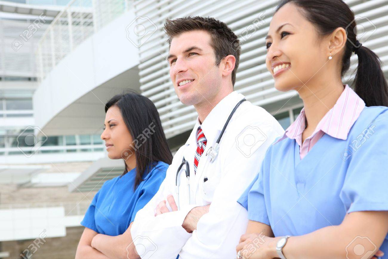 An attractive successful man and woman medical team outside hospital Stock Photo - 6936294