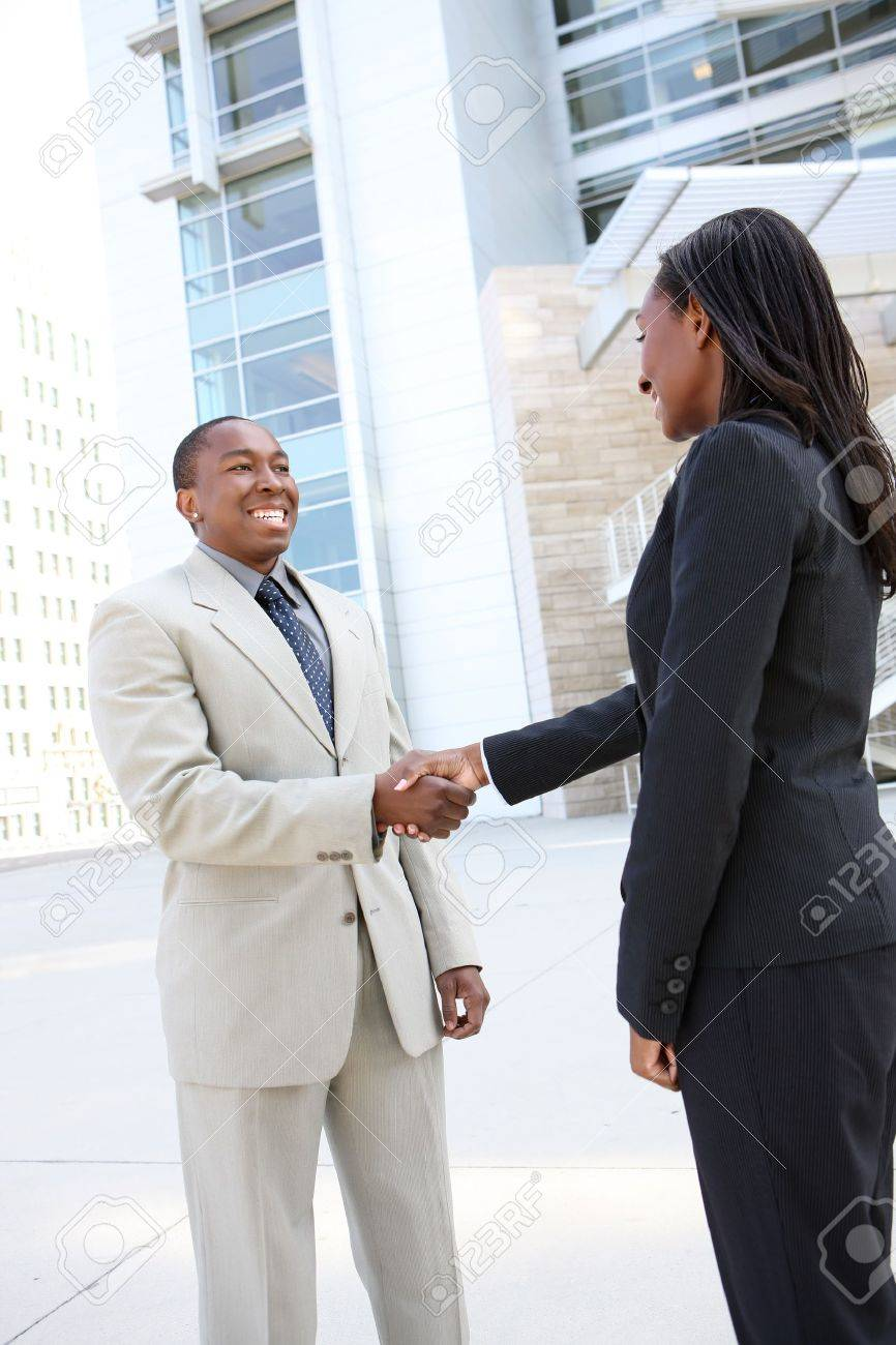 Business people handshake greeting deal at work photo free download - An African American Business Man And Woman Team Handshake At Office Building Stock Photo 7103736