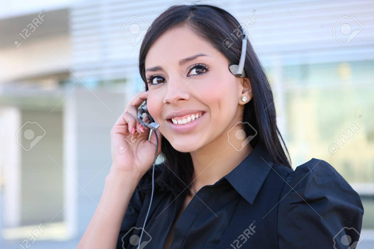 A pretty hispanic customer service business woman on the phone Stock Photo - 8244868