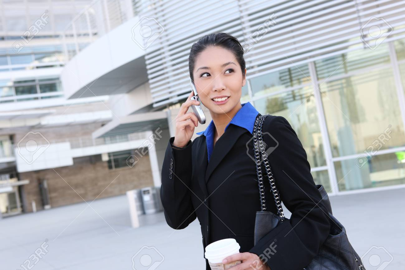 Portrait of pretty asian young  woman with phone at office building Stock Photo - 10051521