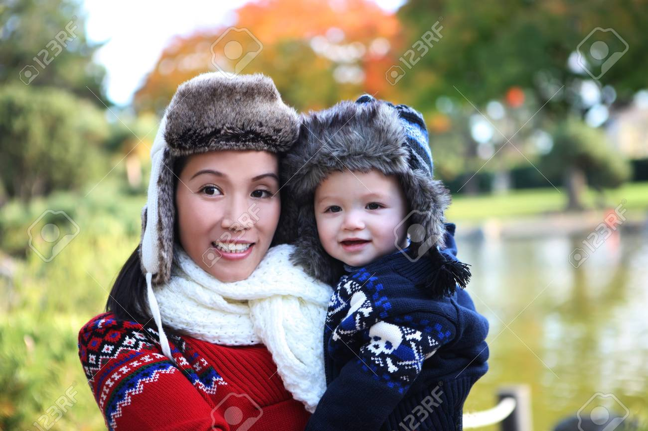 An attractive mother and son in park during the winter season Stock Photo - 12288278