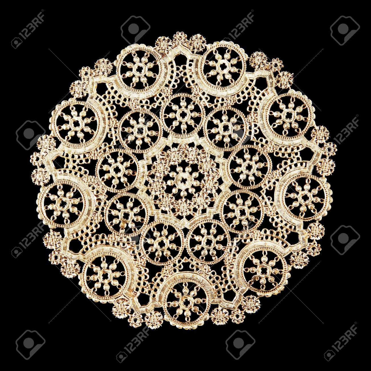 A decorative round doily isolated over black Stock Photo - 16513647