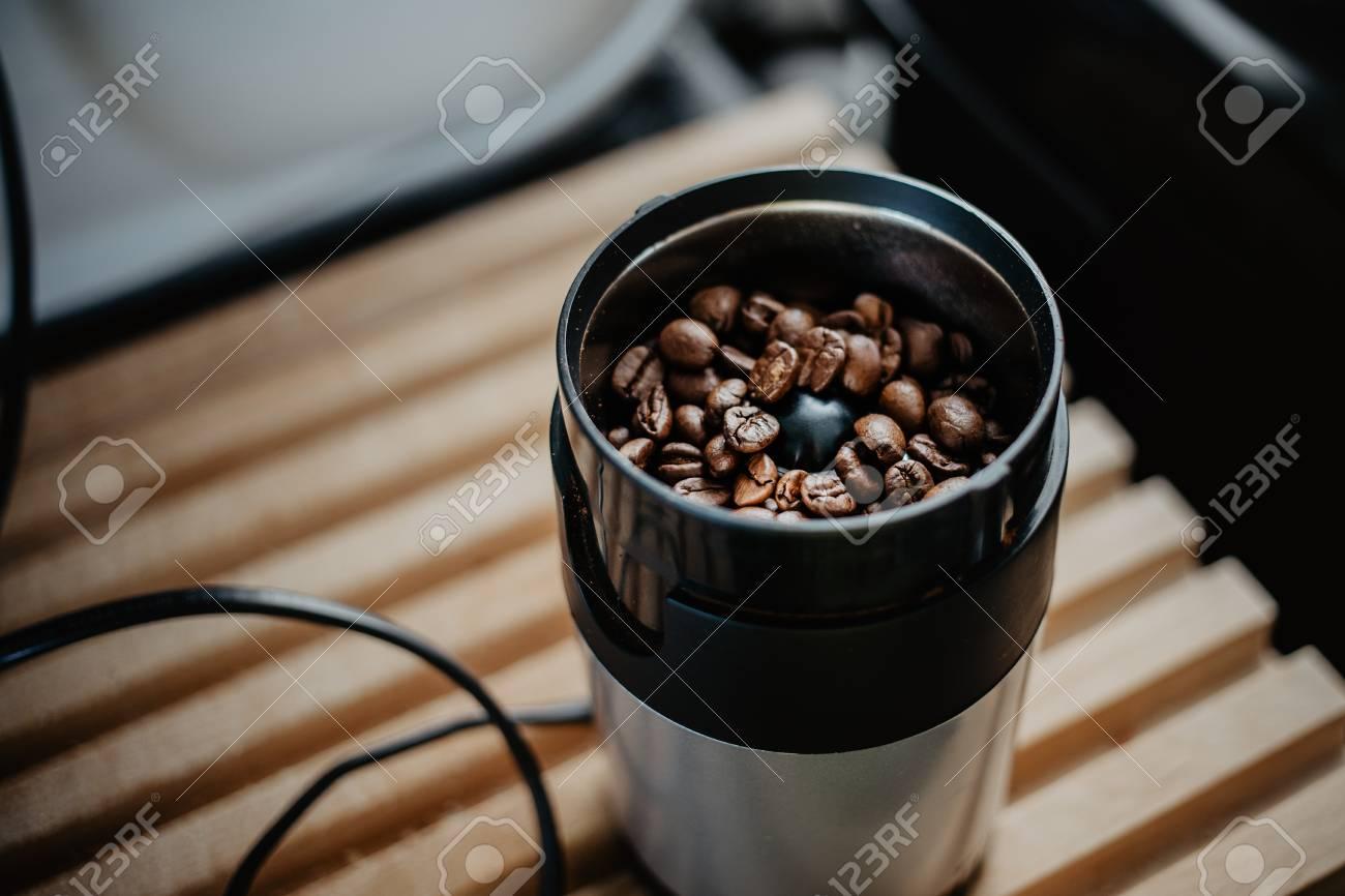 Preparing Fresh Coffee In Moka Pot On Electric Stove Grinding