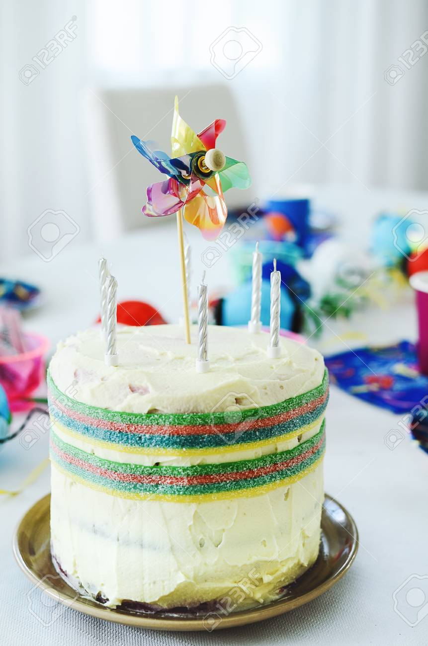 Multi Coloured Kids Birthday Rainbow Cake With Six Candles And