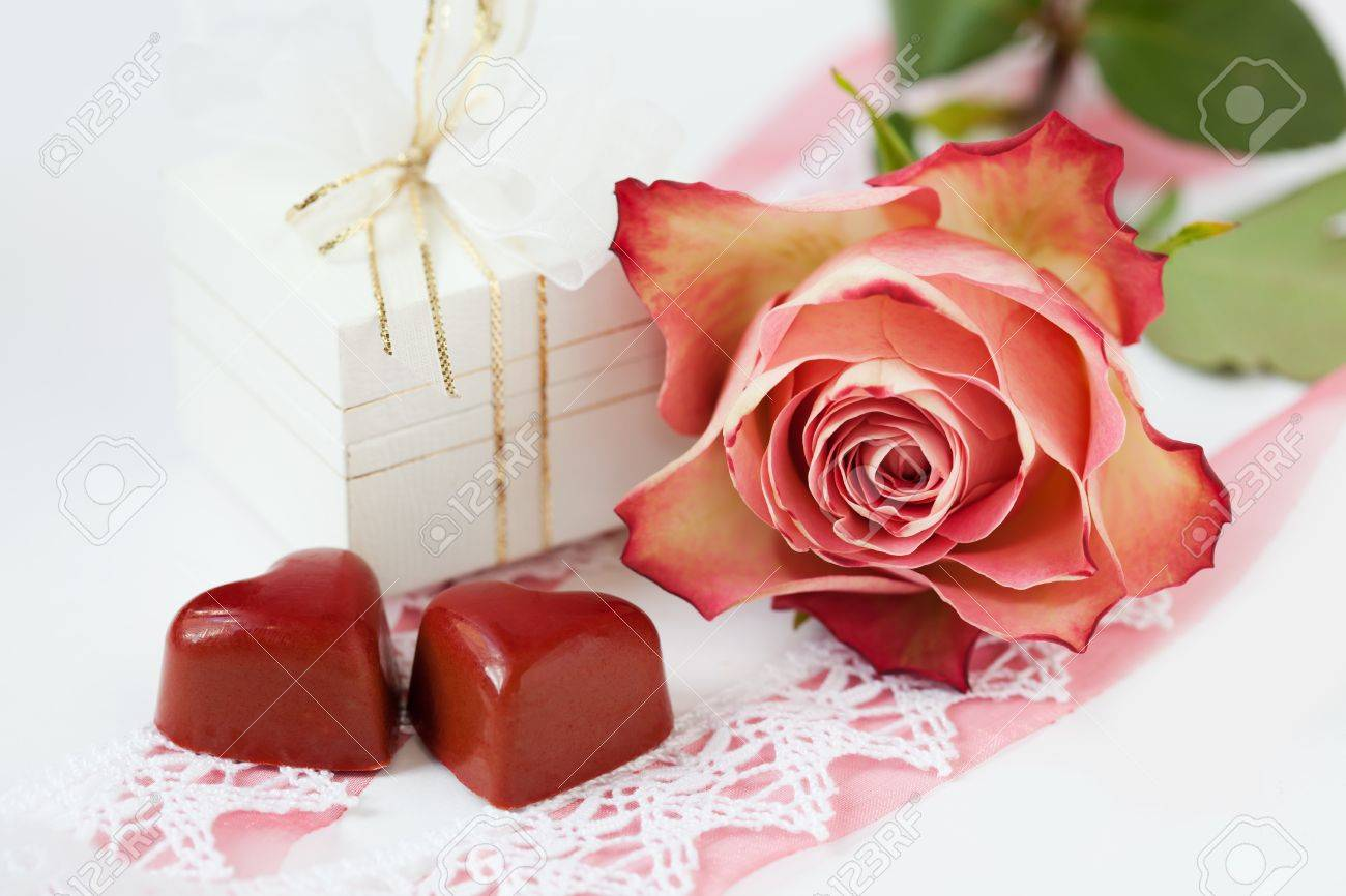 Valentine card with chocolate hearts, rose and gift Stock Photo - 16915672