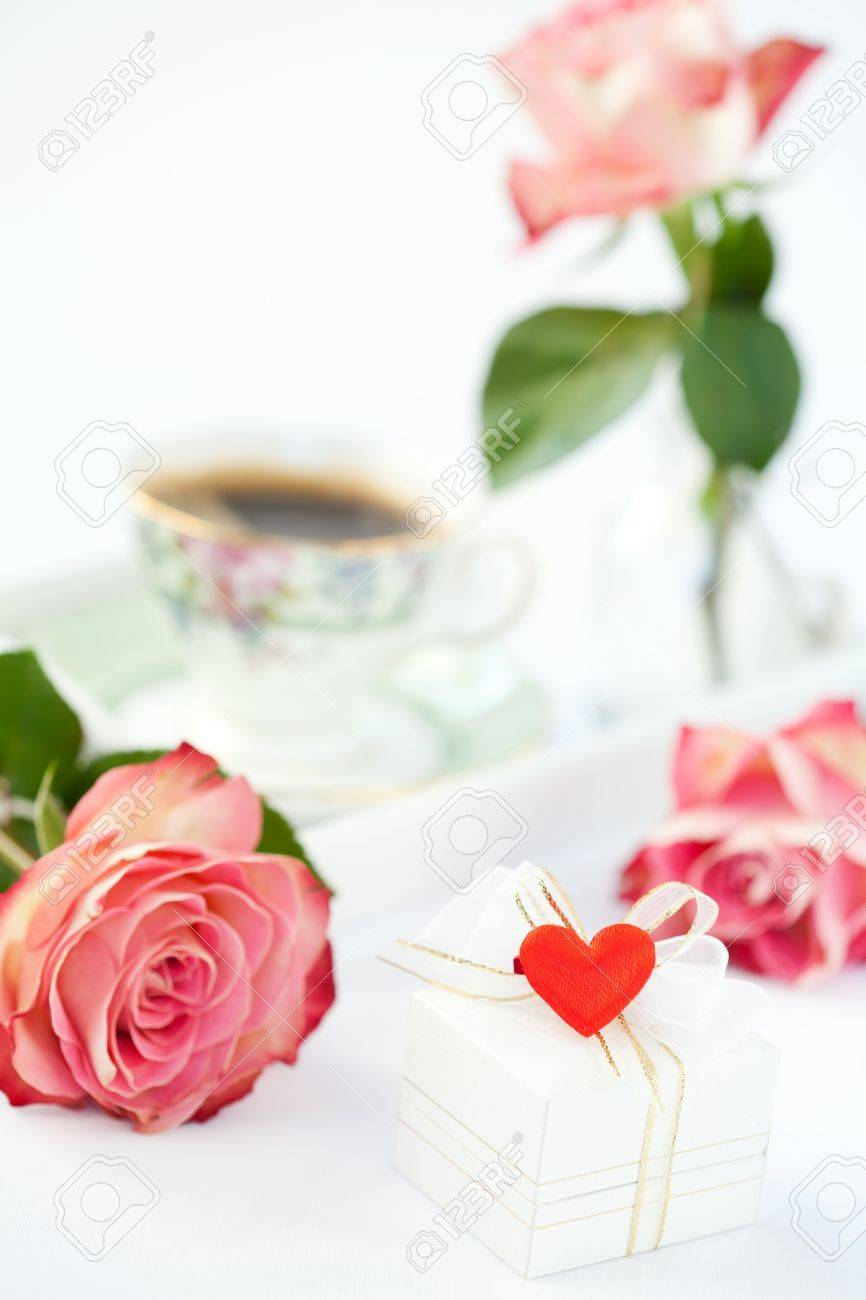 Valentine setup: gift box, roses and cup of coffee Stock Photo - 17236125