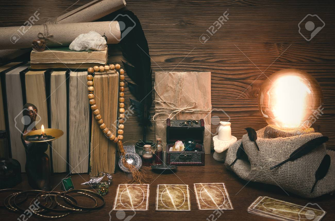 Crystal ball and tarot cards on fortune teller desk  Future reading