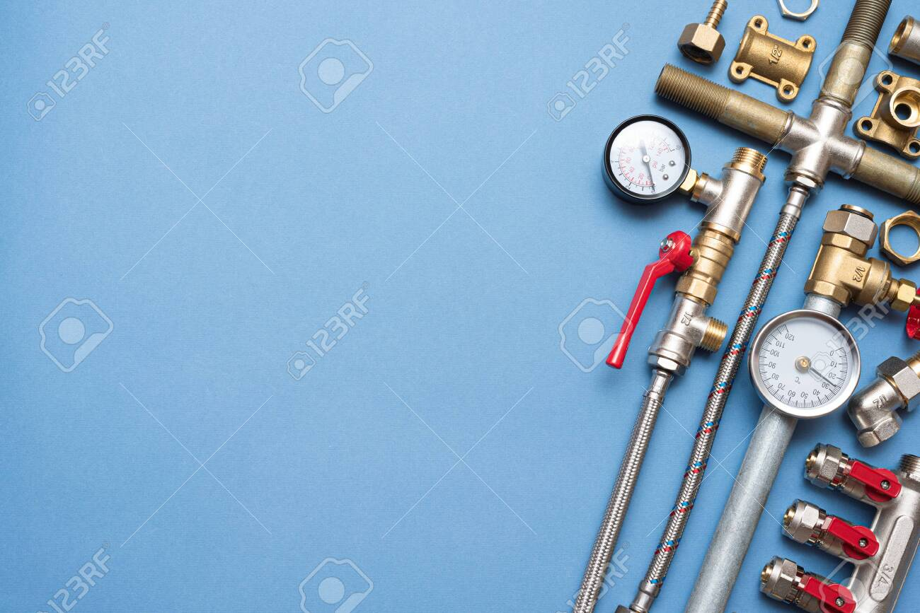 Plumbing flat lay background with copy space. Work tools and pipeline parts on plumber workbench. - 150024571