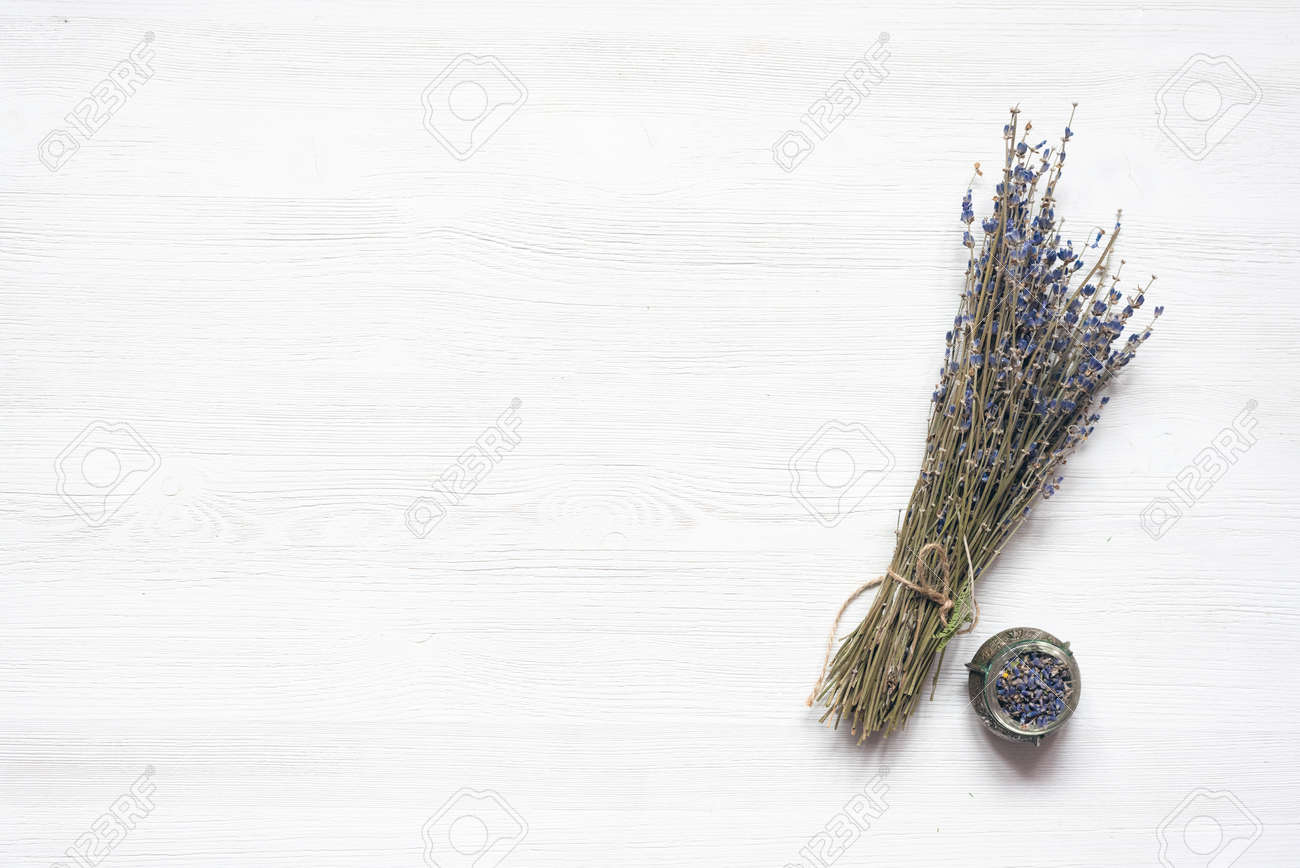 Dried lavender flower branch on a wooden table background with copy space. Herbal medicine concept. - 150055766