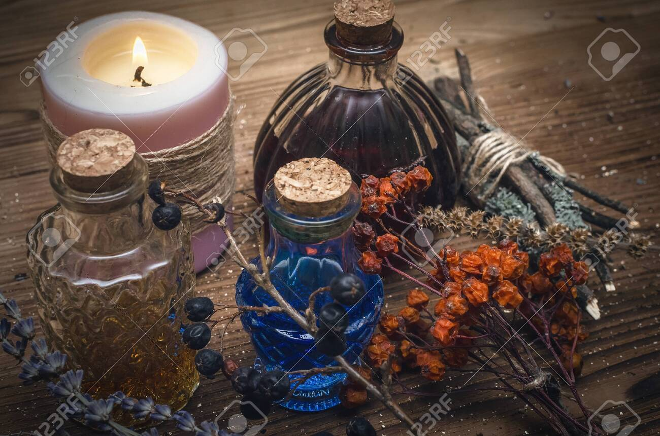 Magic potion. Alternative herbal medicine. Shaman table with copy space. Druidism concept. Witch doctor desk background. - 150113311
