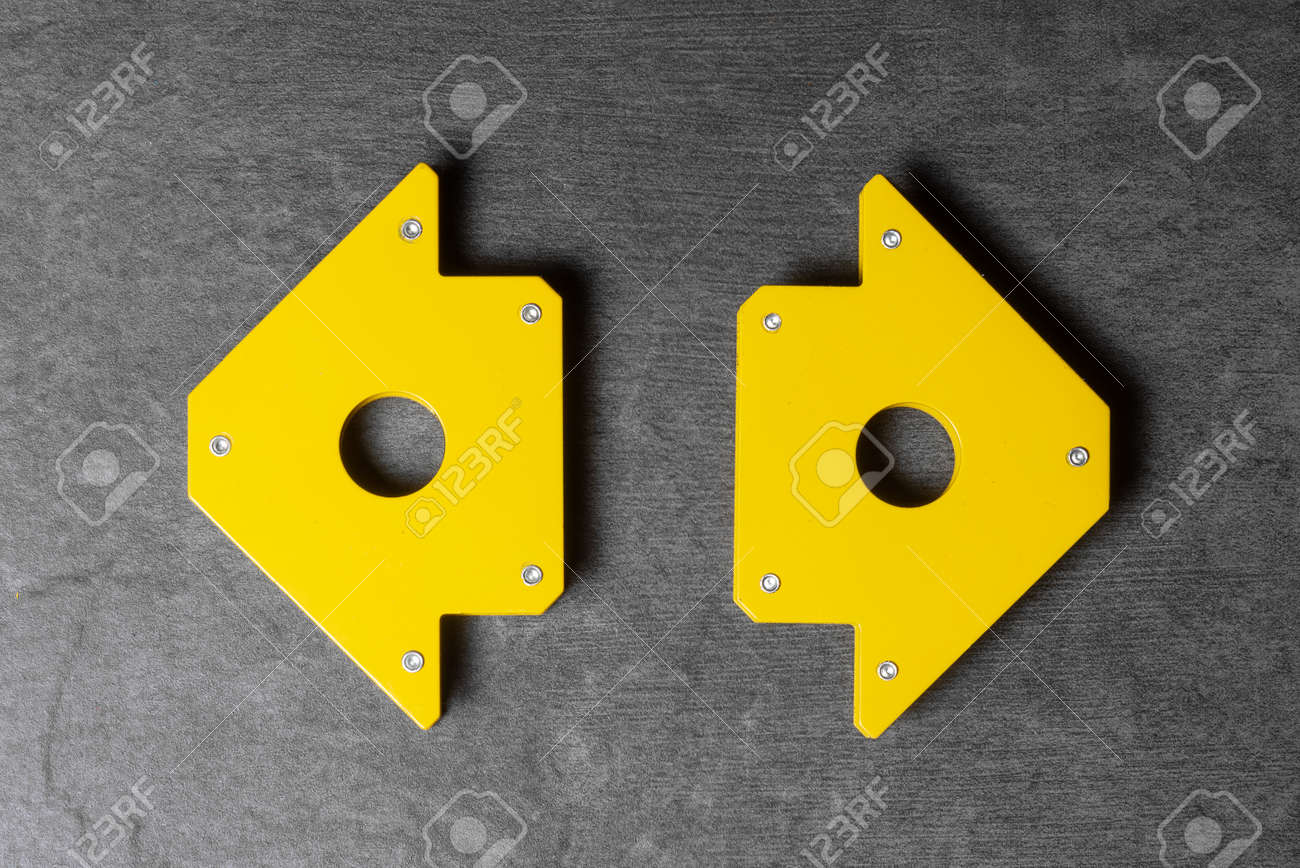 Welding magnetic holders on the gray flat lay background. - 168251755