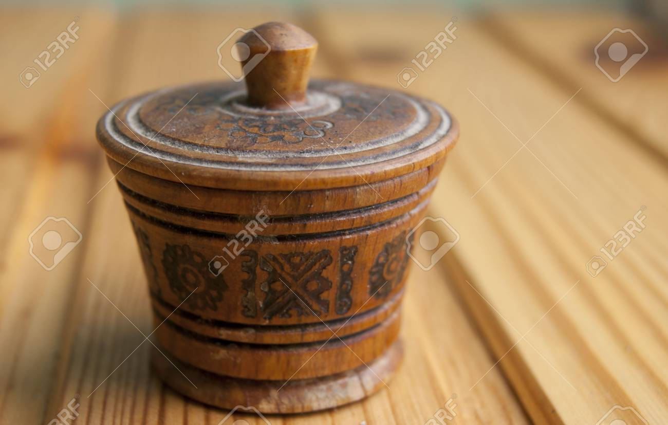 Traditional wood salt-cellar with ornament Stock Photo - 9964581
