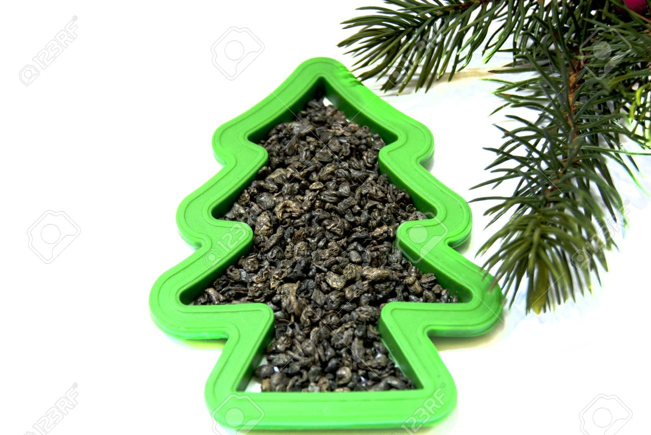 A green fur-tree shape with green tea and a Christmas tree branch Stock Photo - 10324713