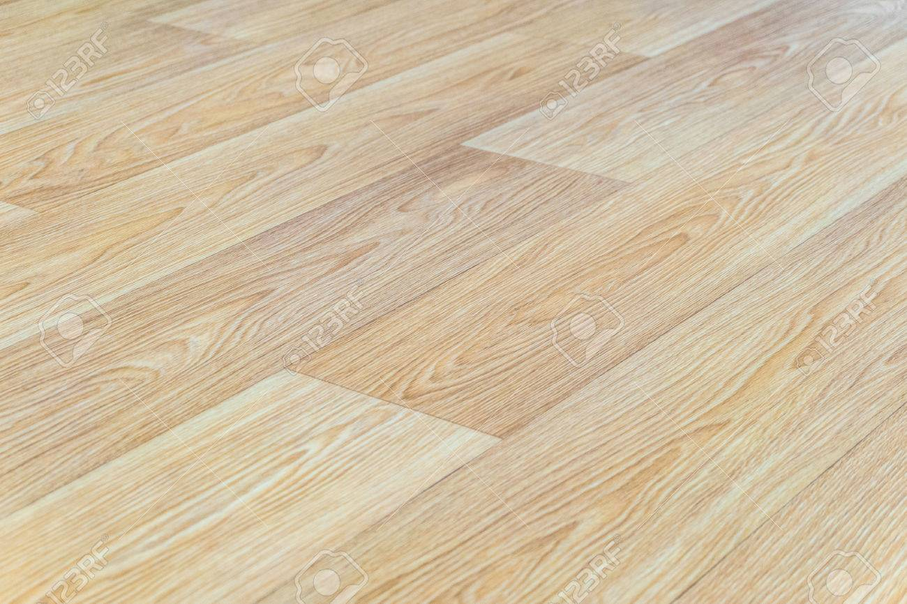 linoleum flooring with embossed light wood texture closeup horizontal layout perspective limited