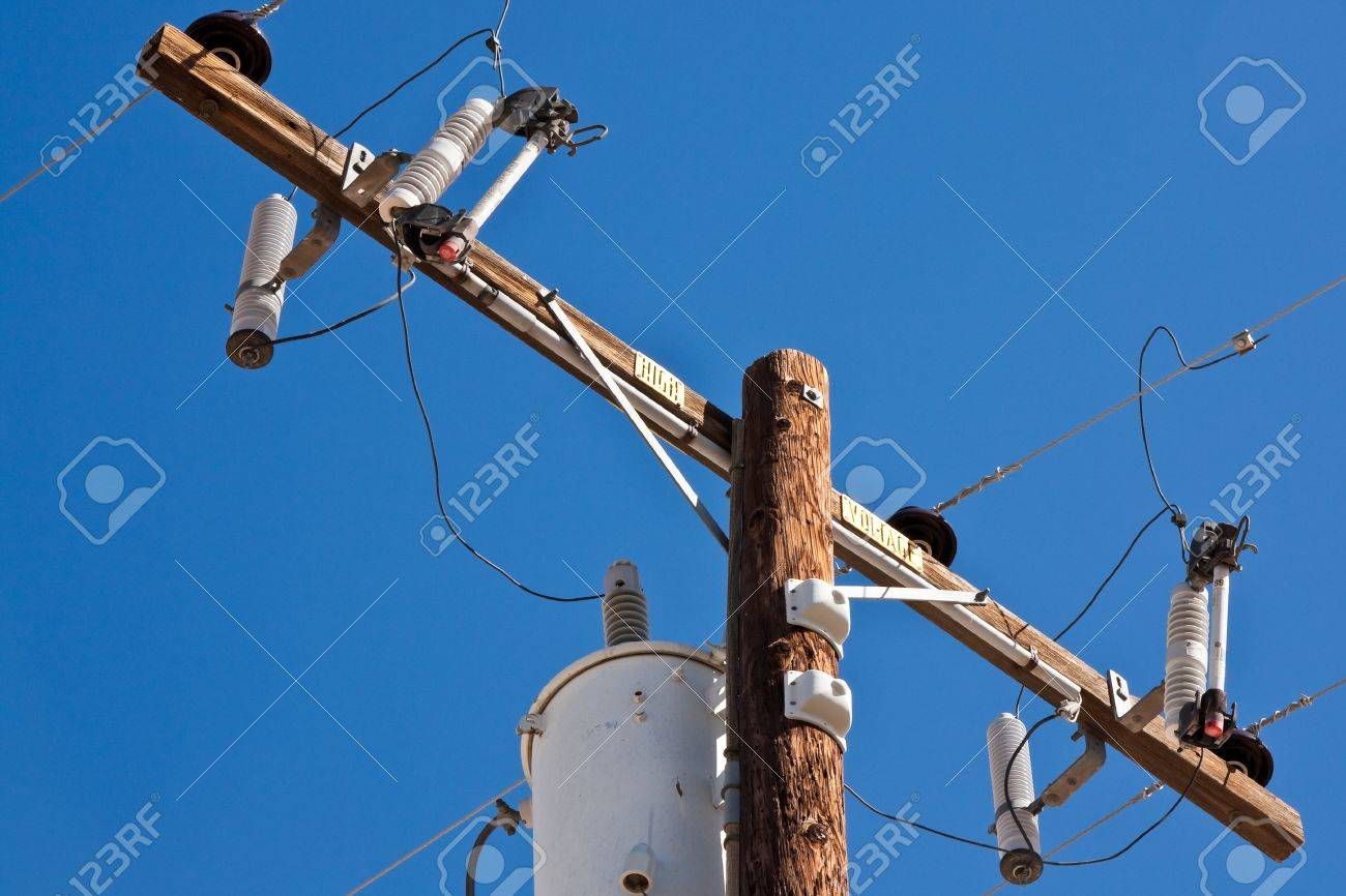 High voltage post against blue sky. Stock Photo - 15555235