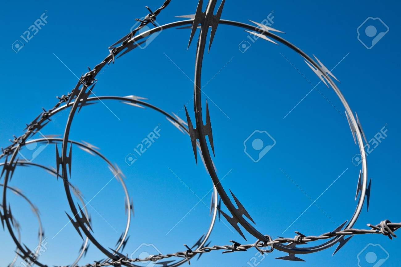 Barbed wire against blue sky at General Patton Museum, California. Stock Photo - 16634727