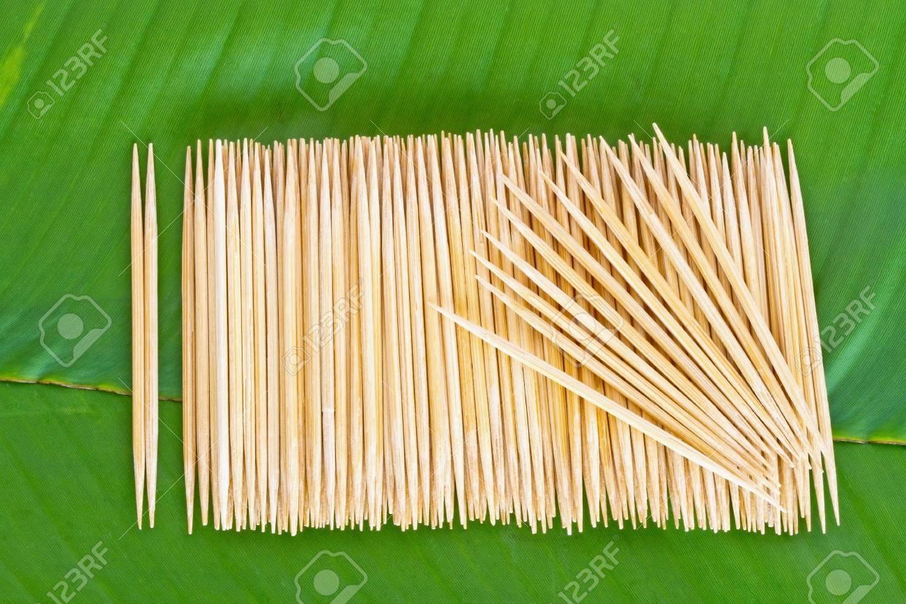 Many scattered toothpicks on banana leaf Stock Photo - 13748128