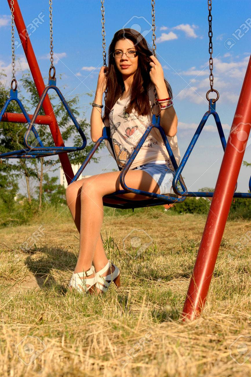 Beautiful Brunette Woman On Swing Stock Photo, Picture And Royalty ...