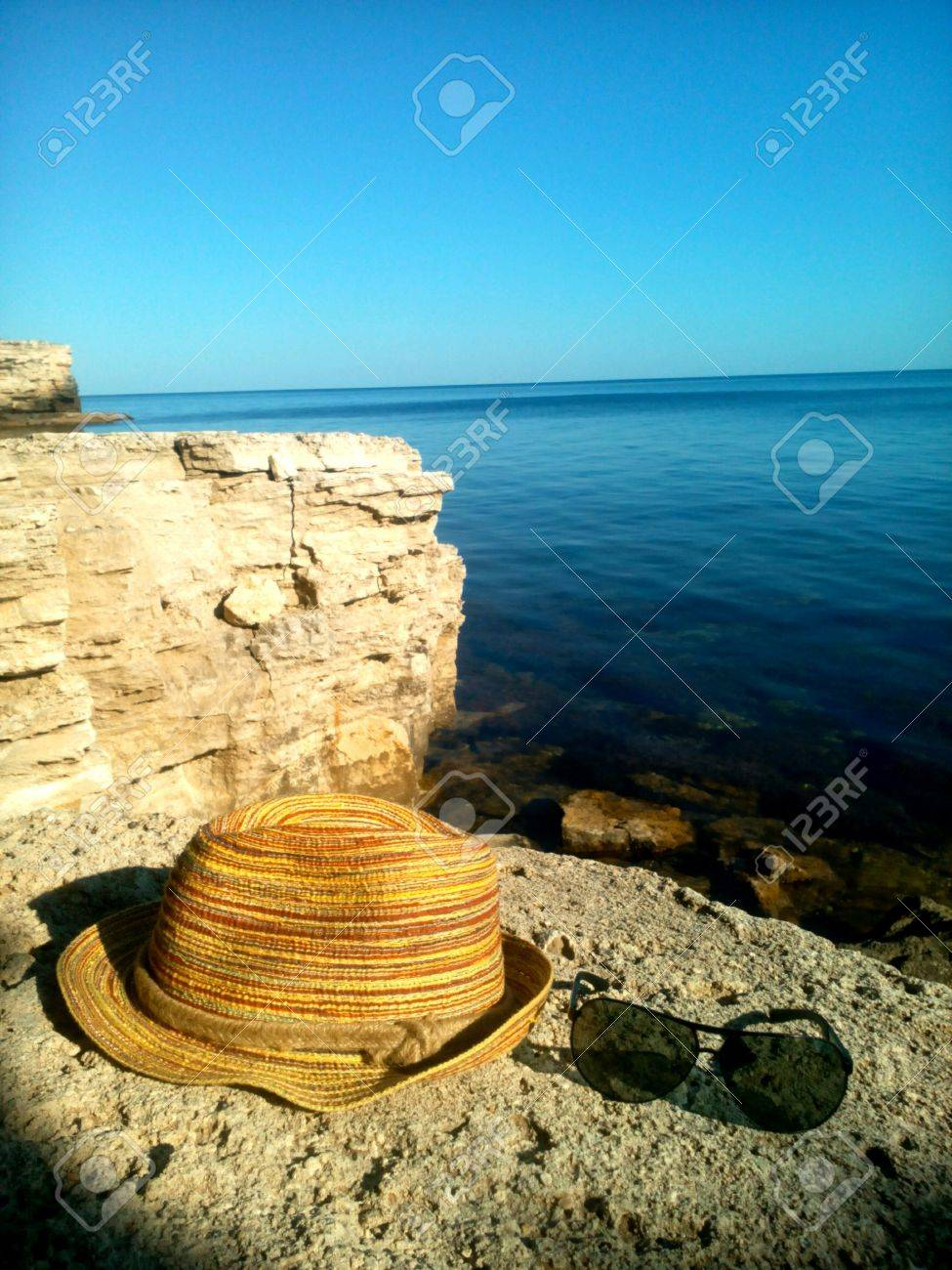 26ed9ad13 Stock Photo Summer Rest Hat And Sunglasses On A Sea Stone Rock Background