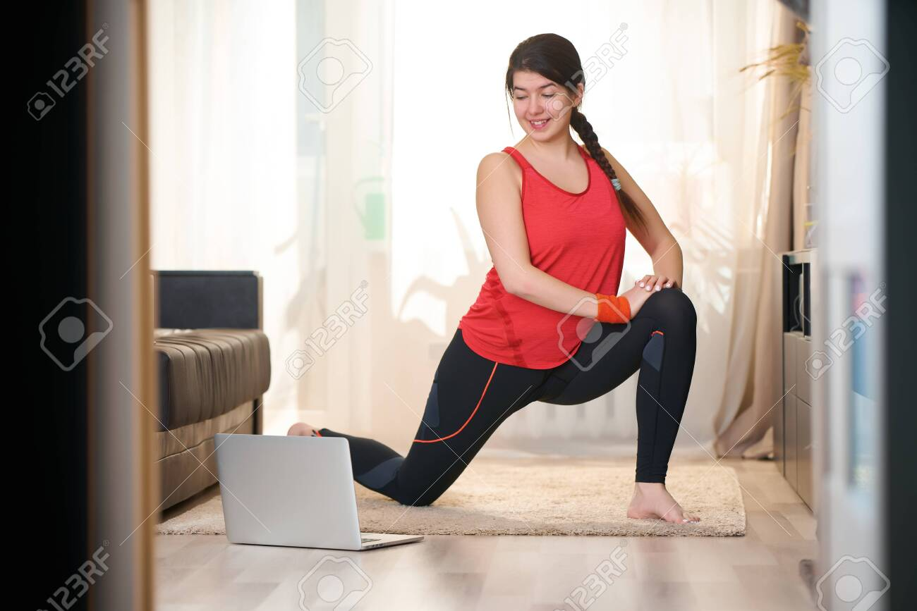 Woman Is Doing Stretching Practicing Yoga Exercises At Home Stock Photo Picture And Royalty Free Image Image 147558522