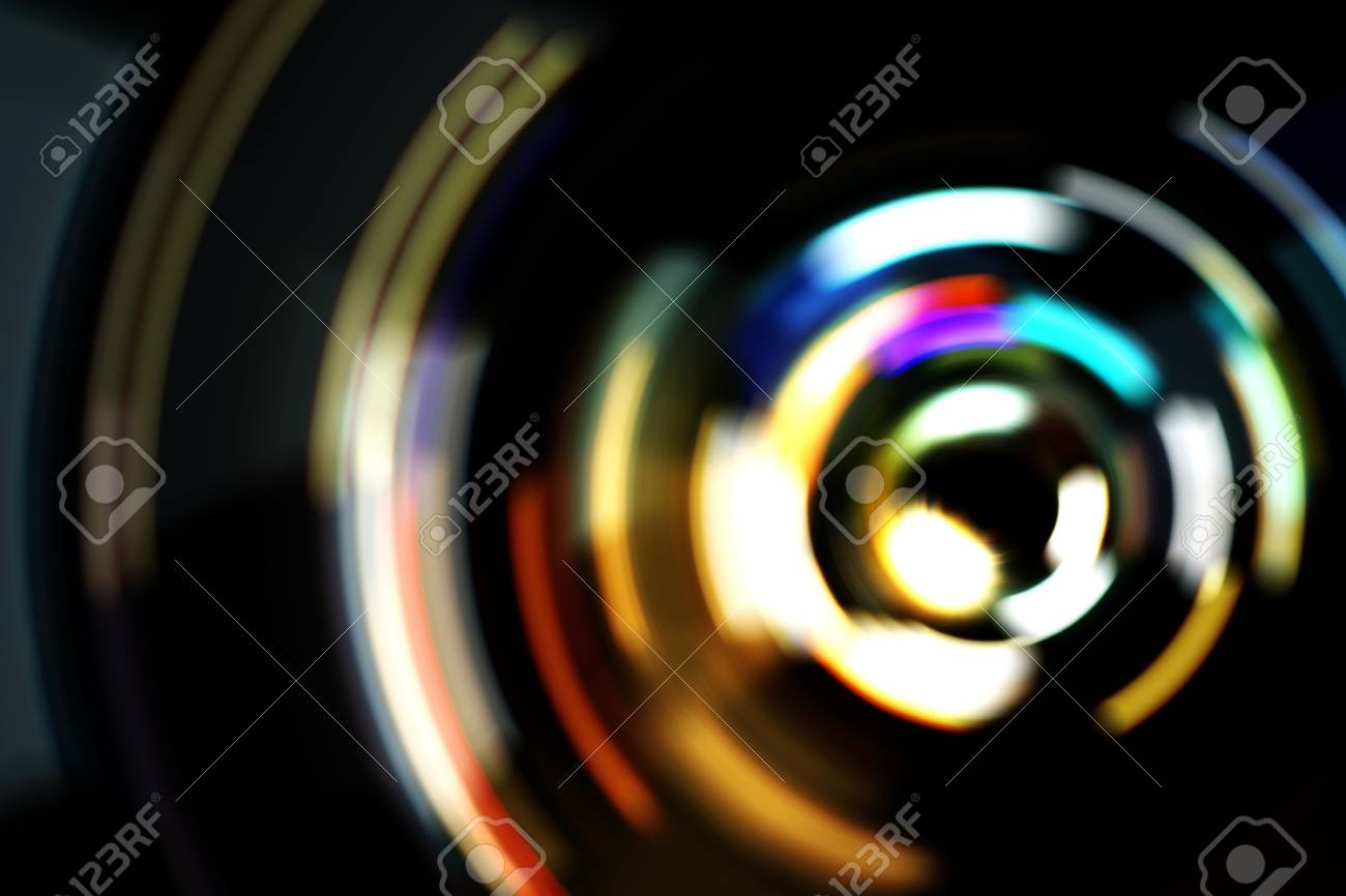 Real Light blur bokeh in dark background from lens out focus. Red blue green yellow light neon at bar.it look like circle light many color blur at night on street in big city in celebration time - 100740163