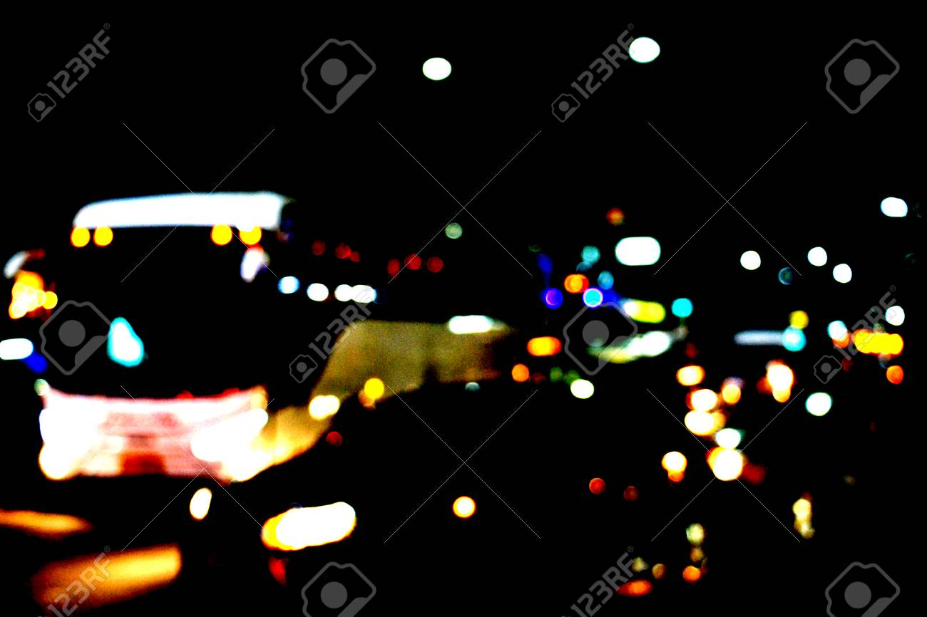 Real Light blur bokeh in dark background from lens out focus. Red blue green yellow light neon at bar.it look like circle light many color blur at night on street in big city in celebration time - 100705752