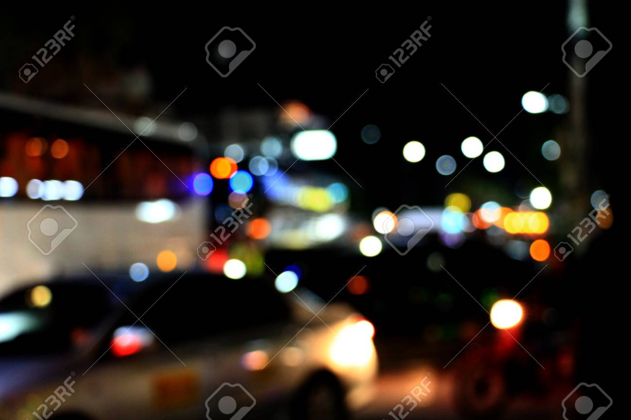 Real Light blur bokeh in dark background from lens out focus. Red blue green yellow light neon at bar.it look like circle light many color blur at night on street in big city in celebration time - 100733831