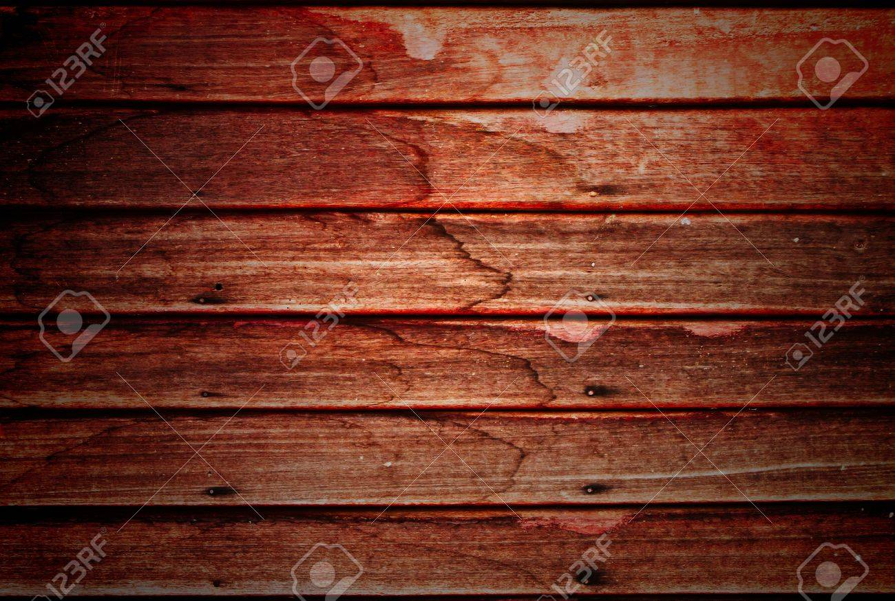 Old wooden wall with rusty nails, spot light at the center Stock Photo - 9710104