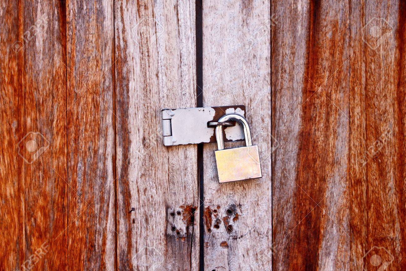 old wooden door locked with padlock Stock Photo - 11866398